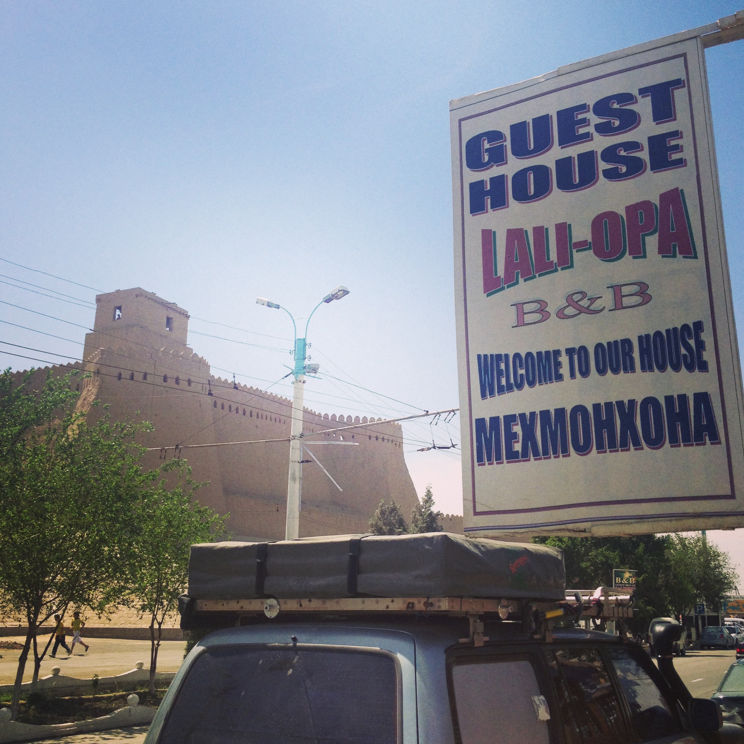 Lali-Opa with Khiva Old Town wall in the background