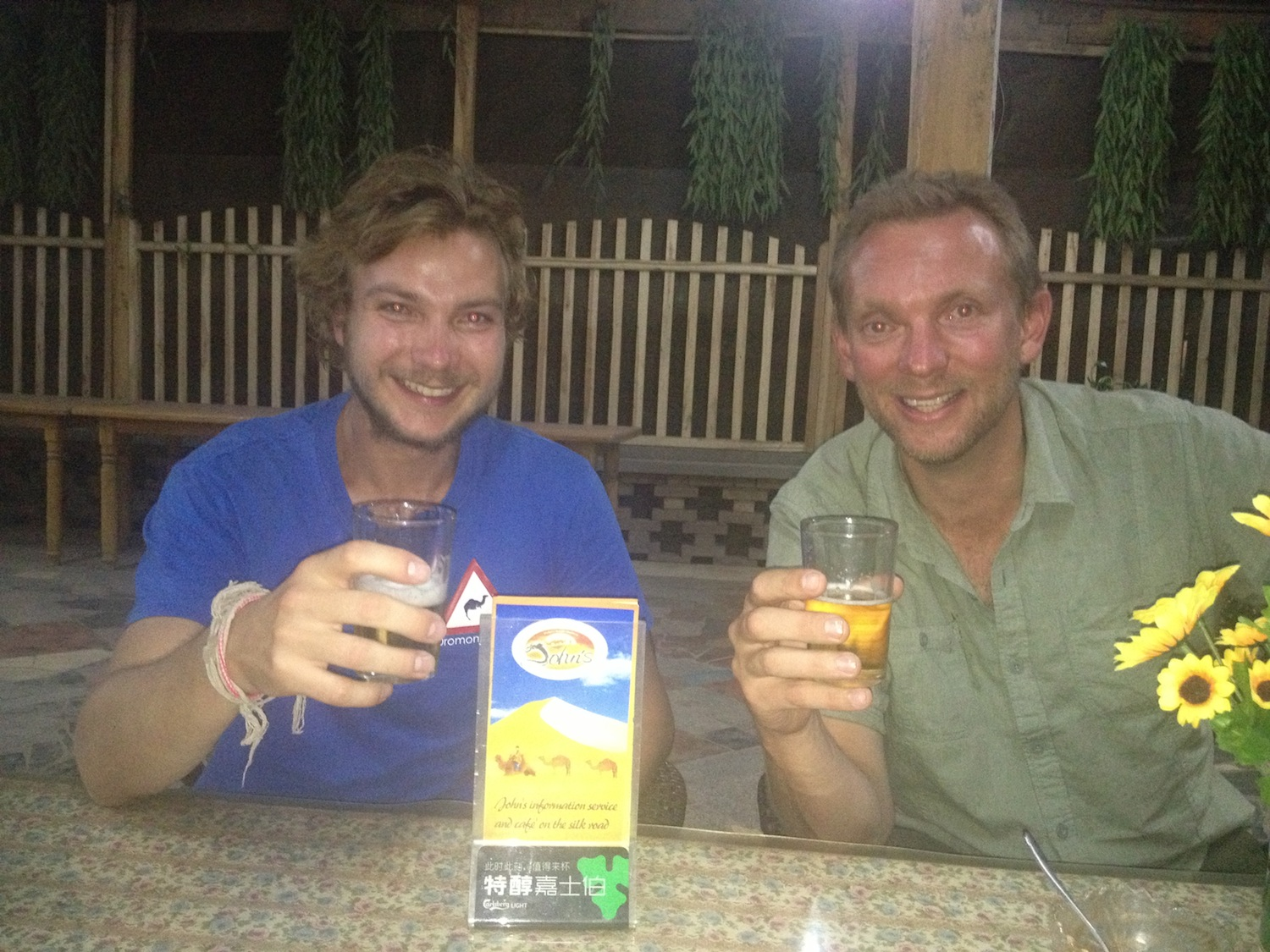 Enjoying a beer with Ed at John's Cafe (Kashgar, China)
