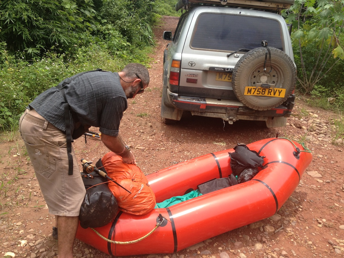 Stu making his final preparations to packraft down the Namtha river (Luang Namtha, Laos)